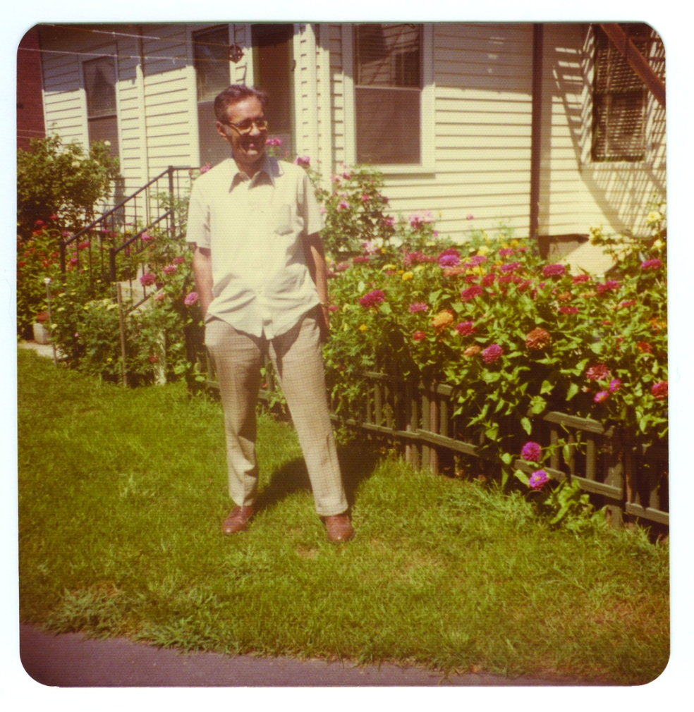 25. Henry in front of the flowers in the 70s